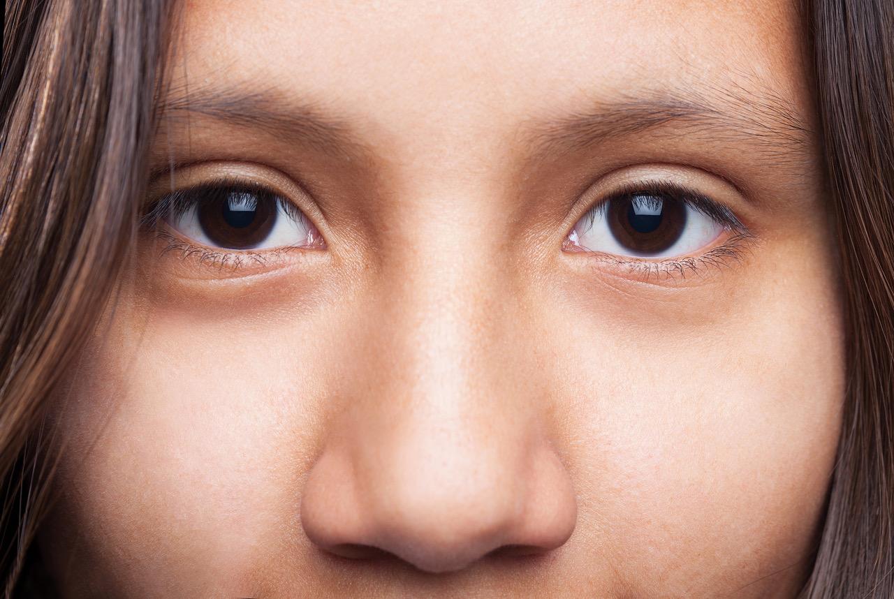 happy latin girl eyes closeup